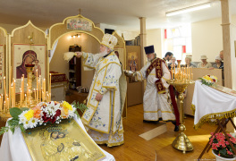 Cambridge, Ontario, Canada. 2 May 2015. Archbishop Gabriel with deacon performs Consecration with Holy Water of the new church of Saint Patriarch Tikhon Confessor and New Martyrs of Russia, during sunday's Divine Liturgy. Fr. Eugene (Schukin) is the dean of the church. His Grace, the Right Reverend Gabriel (Chemodakov) is the ROCOR bishop of Montreal and Canada from May 2008. © Igor Ilyutkin